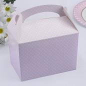 La boîte à gâteau rose à pois