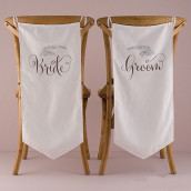 Les 2 housses de chaises bride & groom plume