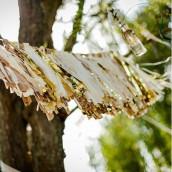 La guirlande de pompons or