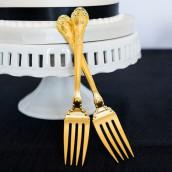 Le duo de fourchettes dorées