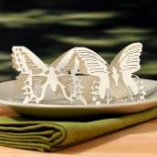 Les 4 marque-places papillon en dentelle de papier
