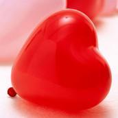 Le ballon coeur en rouge, rose et blanc